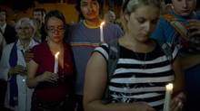 People participate in a candlelight vigil held for the victims of Tuesday night's Metropolis shooting in Montreal September 5, 2012. Canadian police on Wednesday said the suspect who allegedly shot dead a person outside a victory rally for the separatist Parti Quebecois is the owner of a hunting-outfitting business. (OLIVIER JEAN/REUTERS)