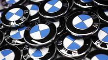 BMW logos are seen next to the production line of the German car manufacturer's plant in the Bavarian city of Dingolfing in this file picture. (MICHAELA REHLE/REUTERS)