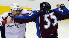 Colorado Avalanche left wing Cody McLeod (55) and Washington Capitals left wing Matt Hendricks (26) fight in the first period of the game at the Pepsi Center. (Ron Chenoy-US PRESSWIRE/Ron Chenoy)