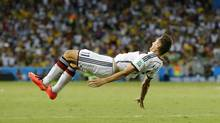 Germany's Miroslav Klose performs a flip as he celebrates after scoring his sides second goal during the group G World Cup soccer match between Germany and Ghana at the Arena Castelao in Fortaleza, Brazil, Saturday, June 21, 2014. (Frank Augstein/AP)