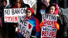 People gathered on Friday, February 3, 2017, in downtown Winnipeg to encourage Mayor Brian Bowman to make Winnipeg a sanctuary city for undocumented migrants. THE CANADIAN PRESS/John Woods