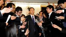 Japan's auto giant Toyota Motor president Akio Toyoda (centre) is surrounded by reporters after meeting with Japanese Transport Minister Seiji Maehara at Maehara's office in Tokyo on February 9, 2010. Toyota announced to recall the company's hybrid vehicle Prius for the brake trouble. (YOSHIKAZU TSUNO/AFP/Getty Images)