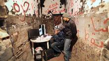 Young rebels use satellite access to stay online during Libya's 2011 uprising: States target the Internet at their peril. (Charla Jones For The Globe and Mail)