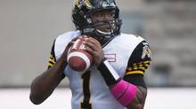 Hamilton Tiger-Cats' quarterback Henry Burris makes a play during first half CFL football action against the Montreal Alouettes in Montreal, Sunday, October 20, 2013.THE CANADIAN PRESS/Graham Hughes (Graham Hughes/The Canadian Press)