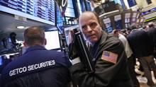 Traders work on the floor of the New York Stock Exchange, March 28, 2012. (BRENDAN MCDERMID/Brendan McDermid/Reuters)