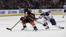 Anaheim Ducks defenceman Hampus Lindholm (47) and Edmonton Oilers left wing Anton Slepyshev (42) battle for the puck during a NHL game at Honda Center. (Kirby Lee/USA Today Sports)