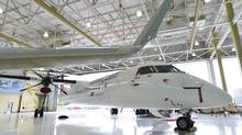 A Bombardier Q400 jet sits in a hangar at the Bombardier facility in Toronto, on Wednesday July 25, 2012. (Aaron Vincent Elkaim/THE CANADIAN PRESS)