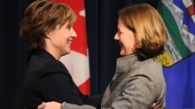 Alberta Premier Alison Redford, right, and B.C. Premier Christy Clark embrace after a joint press conference in Calgary on Oct. 21, 2011. (Larry MacDougal/The Canadian Press)