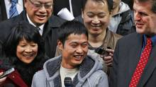 Flanked by NDP MP Olivia Chow, Toronto shopkeeper David Chen leaves court on Oct 29, 2010, after charges in his case were dropped. (Moe Doiron/Moe Doiron/The Globe and Mail)