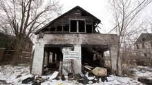 A vacant, burned house is pictured in Detroit's east end on March 19, 2013. There are almost 150,000 vacant or abandoned parcels of land throughout Detroit, covering ground equal to the size of Manhattan. (Deborah Baic/The Globe and Mail)