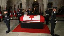 Mr. Layton's family pays their respects as he lies in state on Parliament Hill in Ottawa. (Ryan Remiorz/CP/Ryan Remiorz/CP)