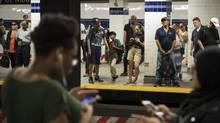 People wait on the subway platform during rush hour at the Jay Street-Metro Tech station in New York City. (Drew Angerer/Getty Images)