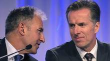 Magna CEO Don Walker, right, confers with CFO Vince Galifi at the company's AGM in Toronto on May 8, 2014. (Chris Young/THE CANADIAN PRESS)