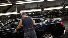 File photo of workers at the General Motors Oshawa assembly plant. (Moe Doiron/The Globe and Mail)