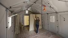 Roberta Russo, a communication officer for the UNHCR, shows one of Ikea's Better Shelters. (Hussein Malla/Associated Press)