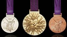 In this image made available by the London Organising Committee of the Olympic Games on Wednesday July 27, 2011 show the London 2012 Olympic medals designed by British artist David Watkins. (AP Photo/LOCOG, HO) (LOGOHD)
