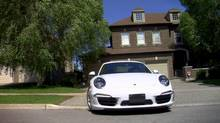 The flyer showed a Porsche parked in the homeowner's driveway.