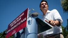 Liberal Leader Justin Trudeau addresses supporters at the B.C. Day Liberal barbeque in Vancouver, B.C., on Monday August 4, 2014. (DARRYL DYCK/THE CANADIAN PRESS)