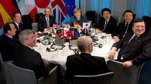Prime Minister Stephen Harper, bottom left, takes part in a meeting with the G7 leaders and EU leaders at Catshuis in The Hague on March 24, 2014.