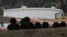 The Alberta Securities Commission is reviewing an environmental group's request to halt a $1.75-billion share sale that Kinder Morgan Inc. plans to help finance the expansion of its Trans Mountain pipeline. (CHRIS HELGREN/REUTERS)