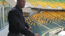 Edmonton Eskimos general manager Ed Hervey looks over Commonwealth Stadium in Edmonton on August 1, 2013. (Dean Bennett/THE CANADIAN PRESS)