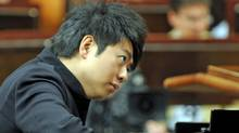 Chinese pianist Lang Lang rehearses for his concert for the inauguration of year-long bicentenary celebrations of the birth of composer Frederic Chopin, on January 7, 2010 in Warsaw. (JANEK SKARZYNSKI/JANEK SKARZYNSKI / AFP/Getty Images)