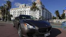 Italian luxury sportscar maker Maserati unveiled its new Quattroporte sedan in Nice, Dec. 10, 2012. The vehicle is the second car built from a shared car body to be launched by Fiat since the start of its 2009 tie-up with Chrysler. (Eric Gaillard/Reuters)