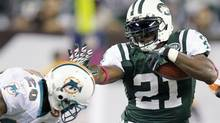 New York Jets running back LaDainian Tomlinson (21) runs for a 12-yard gain in the 4th quarter against the Miami Dolphins at MetLife Stadium. Andrew Mills/US PRESSWIRE (Andrew Mills/US PRESSWIRE)