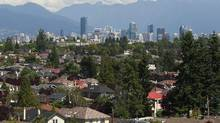 The skyline of Vancouver forms a backdrop for multi-million dollar homes in the Kitsilano and macKensie Heights neighbourhoods of Vancouver, BC August 3, 2011. (Jeff Vinnick For The Globe and Mail/Jeff Vinnick For The Globe and Mail)