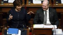 Premier Christy Clark chats with B.C. Finance Minister Mike de Jong before tabling the provincial budget in the Legislative Assembly, Tuesday, February 18, 2014 in Victoria, B.C. (Chad Hipolito/The Canadian Press)