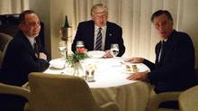 President-elect Donald Trump, center, eats dinner with his chief of staff, Reince Priebus, left, and Mitt Romney at Jean-Georges restaurant in New York on Tuesday. (Evan Vucci/AP)