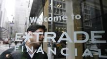 A customer enters the E*Trade offices in New York November 12, 2007. (LUCAS JACKSON/REUTERS)