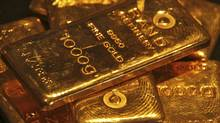 Gold bars are displayed at a gold jewellery shop in the northern Indian city of Chandigarh May 8, 2012. Despite the fresh mess in the euro zone, gold dropped to a four-month low, below $1,600 (U.S.) an ounce. Scared investors are moving into dollars, Treasuries and bonds. But not gold. (Ajay Verma/Reuters/Ajay Verma/Reuters)