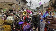 In this Feb. 17, 2015, file photo, revelers play brass band music as they begin the march of the Society of Saint Anne Mardi Gras parade, during Mardi Gras in New Orleans. The NBA All-Star Weekend gets underway in New Orleans on Friday, Feb. 17: the same day the city's Mardi Gras season kicks into high gear. Floats, marching bands and street parties will compete with, or maybe complement, slam dunks, three-point plays and buzzer beaters. (Gerald Herbert/AP)