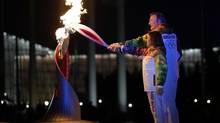 Irina Rodnina and Vladislav Tretiak light the Olympic cauldron during the opening ceremony of the 2014 Winter Olympics in Sochi, Russia, Friday, Feb. 7, 2014. (Matt Slocum/AP)