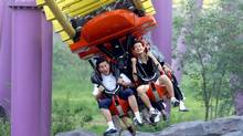 Chinese visitors enjoy a ride at the Happy Valley theme park in Beijing. (STR/AFP/GETTY IMAGES)