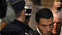 Former trader Jerome Kerviel, centre, arrives at Paris courts for the verdict in his trial. (CHARLES PLATIAU/Charles Platiau/Reuters)