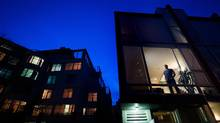 Revard Dufresne stands for a photograph on the second floor his townhouse that recently sold for $1.1-million, in east Vancouver, B.C., on Tuesday February 23, 2016. (DARRYL DYCK/THE GLOBE AND MAIL)