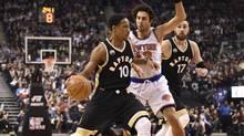 Toronto Raptors all-star guard DeMar DeRozan controls the ball as New York Knicks' Sasha Vujacic defends in Toronto on Jan. 28. (Frank Gunn/THE CANADIAN PRESS)