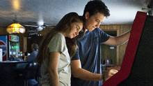 This publicity image released by A24 Films shows Shailene Woodley, left, and Miles Teller in a scene from The Spectacular Now (The Associated Press)