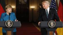 Germany's Chancellor Angela Merkel speaks as U.S. President Donald Trump looks on during their joint news conference in the East Room of the White House in Washington, U.S., March 17, 2017. (JIM_BOURG/REUTERS)