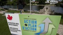 A government action plan sign is seen along the river in Mississippi Mills, Ont., in this August, 2010 photo. (Adrian Wyld/THE CANADIAN PRESS)