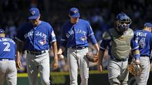 Toronto Blue Jays starting pitcher Aaron Sanchez, center, waits as teammates head off the mound after having a conference against the Seattle Mariners in the third inning of a baseball game Wednesday, Sept. 21, 2016, in Seattle. (Elaine Thompson/AP)