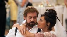 "Paul Giamatti and Minnie Driver in a scene from ""Barney's Version."" (Takashi Seida/AP)"