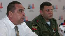 Head of the self-proclaimed Donetsk People's Republic Alexander Zakharchenko, right, and his Luhansk counterpart Igor Plotnitsky attend a news conference in Donetsk, Ukraine, July 8, 2015. (IGOR TKACHENKO/REUTERS)