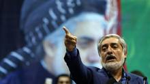 Afghan presidential candidate Abdullah Abdullah gestures during a gathering of his supporters in Kabul, July 8, 2014. Abdullah told thousands of supporters on Tuesday he was the winner of last month's run-off election, putting himself on a collision course with his arch-rival, Ashraf Ghani. REUTERS/Omar Sobhani (AFGHANISTAN - Tags: POLITICS ELECTIONS) (OMAR SOBHANI/REUTERS)