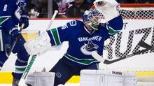 Vancouver Canucks' goalie Cory Schneider makes a glove save against the St. Louis Blues during the first period of an NHL game in Vancouver, B.C., on Tuesday March 19, 2013. (DARRYL DYCK/THE CANADIAN PRESS)