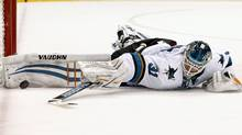San Jose Sharks' Antti Niemi, of Finland, makes a save against against the Arizona Coyotes during the second period of an NHL hockey game Tuesday, Jan. 13, 2015, in Glendale, Ariz. (Associated Press)