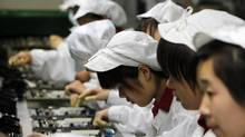 Labour represents less than 5 per cent of overall iPad production costs, so paying fairer wages in China will likely end up costing only slightly more. (Kin Cheung/Associated Press/Kin Cheung/Associated Press)
