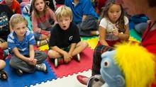 Nurse Karen Drybrough helps Jack Lynch, at left in blue-striped shirt, talk about cancer with his classmates. (Kevin Van Paassen/The Globe and Mail)